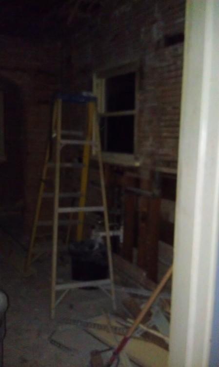 Through the doorway into the kitchen