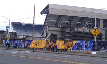 """Husky Stadium and """"The Wall"""" protecting the light rail station currently under construction"""